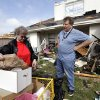 Terri McKeever, left, and her husband Randy, right, talk as they collect personal items from their tornado damaged home Wednesday, April 4, 2012, in Forney, Texas. The mayor of Forney, Texas, says it\'s