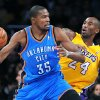 Photo - The Oklahoma City Thunder's Kevin Durant (35) works against the Los Angeles Lakers' Kobe Bryant at Staples Center in Los Angeles, California, on Friday, January 11, 2013. (Wally Skalij/Los Angeles Times/MCT) ORG XMIT: 1133596
