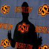 Oklahoma State University (OSU) college football head coach Mike Gundy cast a shadow on the wall as he talks about the upcoming Holiday Bowl football game with the Oregon Ducks during a media luncheon in Stillwater , Okla. December 17, 2008. BY STEVE GOOCH, THE OKLAHOMAN.