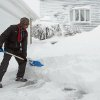 Virgel Mahoro uses a shovel to remove a four-foot high snow drift in his driveway, Saturday, Feb. 9, 2013, in Providence, R.I. (AP Photo/Stew Milne)