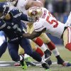 Photo - Seattle Seahawks' Russell Wilson is sacked by San Francisco 49ers' NaVorro Bowman (53) during the first half of the NFL football NFC Championship game Sunday, Jan. 19, 2014, in Seattle. (AP Photo/Marcio Jose Sanchez)