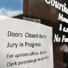 Photo - A sign taped to the east doors of the Greer County Courthouse. Much of the first floor of the building has been closed to visitors because the judge does not want jurors to be disturbed or distracted while they deliberate the fate of Bobbi Parker. The first full day of jury deliberations began Tuesday,  Sep. 20, 2011. after closing arguments were completed in the trial of Bobbi Parker late Monday night.  The trial is in the Greer County Courthouse in Mangum, Okla.  Photo by Jim Beckel, The Oklahoman