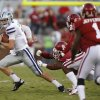 Kansas State\'s Collin Klein (7) runs past the Sooner defense during the college football game between the University of Oklahoma Sooners (OU) and the Kansas State University Wildcats (KSU) at the Gaylord Family-Memorial Stadium on Saturday, Sept. 22, 2012, in Norman, Okla. Photo by Chris Landsberger, The Oklahoman