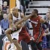 Miami Heat\'s Dwyane Wade (3) defends Utah Jazz\'s Richard Jefferson, during the first quarter of an NBA basketball game Saturday, Feb. 8, 2014, in Salt Lake City. (AP Photo/Rick Bowmer)