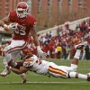 Oklahoma\'s Trey Millard (33) is brought down by Iowa State\'s Ter\'Ran Benton (22) during a college football game between the University of Oklahoma Sooners (OU) and the Iowa State University Cyclones (ISU) at Gaylord Family-Oklahoma Memorial Stadium in Norman, Okla., Saturday, Nov. 26, 2011. Photo by Bryan Terry, The Oklahoman