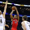 Photo - Toronto Raptors guard DeMar DeRozan (10) shoots the ball over New Orleans Pelicans center Greg Stiemsma (34) and New Orleans Pelicans center Jeff Withey (5) during the first half of an NBA basketball game in New Orleans, Wednesday, March 19, 2014. (AP Photo/Jonathan Bachman)