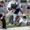 Edmond North\'s Marque Depp tries to get by Edmond Memorial\'s Tyren Lawson during the high school football game between Edmond North and Edmond Memorial at Wantland Stadium in Edmond, Okla., Friday, Aug. 31, 2012. Photo by Sarah Phipps, The Oklahoman