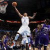 Oklahoma City\'s Russell Westbrook (0) flies to the hoop past Sacramento\'s Marcus Thornton (23), Donte Greene (20), Jason Thompson (34) and Isaiah Thomas (22) during the NBA basketball game between the Oklahoma City Thunder and the Sacramento Kings at Chesapeake Energy Arena in Oklahoma City, Friday, April 13, 2012. Photo by Nate Billings, The Oklahoman