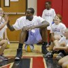 Oklahoma City Thunder\'s Kendrick Perkins gives out high fives to participants in the Oklahoma City Thunder basketball camp at Mid-America Christian University on Wednesday, June 19, 2013 in Oklahoma City, Okla. Photo by Chris Landsberger, The Oklahoman