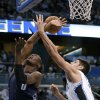 Orlando Magic\'s Nikola Vucevic, right, of Montenegro, fouls Charlotte Bobcats\' Bismack Biyombo (0) as Vucevic tries to block a shot during the first half of an NBA basketball game, Friday, Jan. 18, 2013, in Orlando, Fla. (AP Photo/John Raoux)