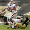 Oklahoma\'s D.J. Wolfe (25) pulls in an interception against Colorado during the first half of the college football game between the University of Oklahoma Sooners (OU) and the University of Colorado Buffaloes (CU) at Folsom Field in Boulder, Co., on Saturday, Sept. 29, 2007. By NATE BILLINGS, The Oklahoman ORG XMIT: KOD