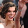 Milla Jovovich arrives before the 84th Academy Awards on Sunday, Feb. 26, 2012, in the Hollywood section of Los Angeles. (AP Photo/Joel Ryan) ORG XMIT: OSC152