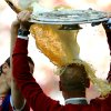 Photo - Munich's coach Pep Guardiola from Spain  gets a beer shower by Belgian player Daniel van Buyten, left, as  celebrates with the German championships trophy at the end of the GermanBundesliga soccer  match between FCBayern Munich and VfB Stuttgart at Allianz Arena in Munich, Germany,  Saturday May 10, 2014.  (AP Photo/dpa,Andreas Gebert)