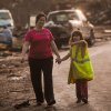 Summer Roberts and her daughter Addyson Roberts, 7, hold hands after being reuinted after the tornado struck their home on May 20, 2013. Photo by KT King, The Oklahoman