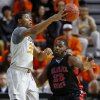 Oklahoma State\'s Marcus Smart (33) passes the ball by Delaware State\'s Jason Owens (23) during an NCAA college basketball between Oklahoma State University and Delaware State at Gallagher-Iba Arena in Stillwater, Okla., Tuesday, December 17, 2013. Photo by Bryan Terry, The Oklahoman