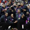 United States\' men\'s basketball team celebrate after winning the gold medal against Spain at the 2012 Summer Olympics, Sunday, Aug. 12, 2012, in London. (AP Photo/Charles Krupa)