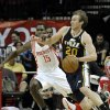Utah Jazz\'s Gordon Hayward (20) tries to drive the ball past Houston Rockets\' Toney Douglas (15) in the first half of an NBA basketball game on Saturday, Dec. 1, 2012, in Houston. (AP Photo/Pat Sullivan)