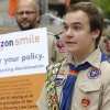 Photo - Pascal Tessier, 17, a gay Eagle Scout from Kensington, Md., speaks in front of a group of Boy Scouts and scout leaders, Wednesday, May 21, 2014, outside the headquarters of Amazon.com in Seattle. The group delivered a petition to Amazon that was started as an online effort by Tessier and gathered more than 125,000 signatures, urging Amazon to stop donating money to the Boy Scouts due to the organization's policy of excluding openly gay adults from leadership positions, despite recently accepting gay youth as scouts. (AP Photo/Ted S. Warren)