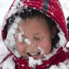 Cameron Willson, 10, has a faceful of snow after being hit with a snowball Monday morning March 25, 2013 during a neighborhood snowball fight in Fort Wayne, Indiana. (AP Photo/The Journal Gazette, Swikar Patel) NEWS-SENTINEL OUT; MANDATORY CREDIT; NO SALES; MAGS OUT