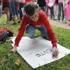 Kathy Rand, of Norman, makes a sign for a women\'s rights march to the Oklahoma State Capitol in Oklahoma City, Saturday, April 28, 2012. The demonstration was put on by Unite Women, who organized other demonstrations throughout the world to protest legislation that restricts reproductive rights. Photo by Garett Fisbeck, For The Oklahoman