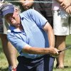 Photo - Colin Montgomerie watches his chip shot onto the ninth green during the second round of the U.S. Senior Open golf tournament at Oak Tree National in Edmond, Okla., Friday, July 11, 2014. (AP Photo/Sue Ogrocki)