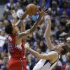 Photo - Los Angeles Clippers forward Matt Barnes (22) steals the ball from Dallas Mavericks forward Dirk Nowitzki during the first half of an NBA basketball game Thursday, March 27, 2014, in Dallas. (AP Photo/LM Otero)