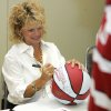 Photo - OU, SIGN, AUTOGRAPH: University of Oklahoma women's college basketball head coach Sherri Coale autographs a ball at the National Cowboy & Western Heritage Museum in Oklahoma City , Okla. August  7 , 2008.  BY STEVE GOOCH, THE  OKLAHOMAN.  ORG XMIT: KOD