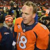 Photo - Denver Broncos quarterback Peyton Manning walks off the field after Denver beat the San Diego Chargers 24-17 in an NFL AFC division playoff football game, Sunday, Jan. 12, 2014, in Denver. (AP Photo/Jack Dempsey)