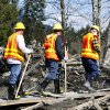 Washington State Department of Transportation workers enter the mudslide site on a constructed path of plywood on Highway 530 near mile marker 37, near Oso, Wash., Tuesday, April 1, 2014. The death toll from the March 22 mudslide has increased to 28. (AP Photo/The Seattle Times, Lindsey Wasson) SEATTLE OUT; USA TODAY OUT; MAGS OUT; TELEVISION OUT; NO SALES; MANDATORY CREDIT TO BOTH THE SEATTLE TIMES AND THE PHOTOGRAPHER