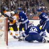 Philadelphia Flyers\' Wayne Simmonds, second from left, celebrates scoring on Toronto Maple Leafs goaltender James Reimer as Flyers\' Danny Briere, left, and Leafs\' Dion Phaneuf (3) and Korbinian Holzer (55) watch during the first period of their NHL hockey game, Monday, Feb. 11, 2013, in Toronto. (AP Photo/The Canadian Press, Chris Young)