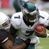 Photo -   Philadelphia Eagles quarterback Michael Vick, right, is sacked by Arizona Cardinals linebacker Daryl Washington, left, in the second quarter of an NFL football game on Sunday, Sept. 23, 2012, in Glendale, Ariz. (AP Photo/Paul Connors)