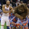 Oklahoma City\'s Derek Fisher (6) helps Rumble the Bison up during an NBA basketball game between the Oklahoma City Thunder and the Philadelphia 76ers at Chesapeake Energy Arena in Oklahoma City, Tuesday, March 4, 2014. Oklahoma City won 125-92. PHOTO BY BRYAN TERRY, The Oklahoman