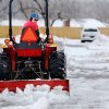 Snowfall came to an end Friday night and many Oklahomans spent time Saturday, Jan. 30, 2010, clearing snow and ice from their vehicles, driveways and sidewalks. Anthony Cuchiara drives a tractor with a grading blade attached to it that allows him to remove snow from the parking lot of his appliance store at Reno and Sooner Road in Midwest City. Photo by Jim Beckel, The Oklahoman