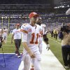Photo - Kansas City Chiefs quarterback Alex Smith (11) leaves the field after an NFL wild-card playoff football game against the Indianapolis Colts Saturday, Jan. 4, 2014, in Indianapolis. Indianapolis defeated Kansas City 45-44. (AP Photo/AJ Mast)