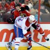 Photo - Ottawa Senators' Chris Neil is hit by Montreal Canadiens' Travis Moen during the first period of an NHL hockey game in Ottawa, Ontario, on Monday, Feb 25, 2013. (AP Photo/The Canadian Press, Sean Kilpatrick)