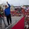 Venezuela\'s President Hugo Chavez holding hands with his daughter Rosa Virginia, left, gestures to supporters during a campaign rally in Yaracuy, Venezuela, Tuesday, Oct. 2, 2012. Venezuela\'s presidential election is scheduled for Oct. 7. (AP Photo/Rodrigo Abd)