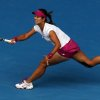 Photo - Li Na of China reaches for a shot to Flavia Pennetta of Italy during their quarterfinal at the Australian Open tennis championship in Melbourne, Australia, Tuesday, Jan. 21, 2014.(AP Photo/Eugene Hoshiko)