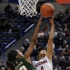 Photo - Connecticut's Moriah Jefferson (4) drives past South Florida's Courtney Williams (10) during the first half of an NCAA college basketball game in Hartford, Conn., Sunday, Jan. 26, 2014. (AP Photo/Fred Beckham)