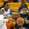 Oklahoma State\'s Toni Young (15) and West Virginia\'s Averee Fields (5) go for the ball during a women\'s college basketball game between Oklahoma State and West Virginia at Gallagher-Iba Arena in Stillwater, Okla., Tuesday, Jan. 29, 2013. Photo by Bryan Terry, The Oklahoman