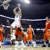 Oklahoma\'s Taylor Griffin (32) drives to the basket against the Syracuse defense during the second half of the NCAA Men\'s Basketball Regional at the FedEx Forum on Friday, March 27, 2009, in Memphis, Tenn. PHOTO BY CHRIS LANDSBERGER, THE OKLAHOMAN