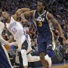 Utah Jazz\'s DeMarre Carroll (3) fouls Oklahoma City Thunder\'s Kevin Durant (35) during the NBA basketball game between the Oklahoma City Thunder and the Utah Jazz at Chesapeake Energy Arena on Wednesday, March 13, 2013, in Oklahoma City, Okla. Photo by Chris Landsberger, The Oklahoman