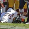 Photo - Chicago Bears quarterback Jay Cutler lies on the field after being injured in a sack by Washington Redskins defensive end Chris Baker during the first half of a NFL football game in Landover, Md., Sunday, Oct. 20, 2013. (AP Photo/Alex Brandon)
