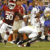 Oklahoma\'s Javon Harris (30) and Oklahoma\'s Jamell Fleming (32) take down Tulsa\'s Willie Carter (34) after a long pass play during the second half of the college football game between the University of Oklahoma Sooners ( OU) and the Tulsa University Hurricanes (TU) at the Gaylord Family-Memorial Stadium on Saturday, Sept. 3, 2011, in Norman, Okla. Photo by Steve Sisney, The Oklahoman ORG XMIT: KOD