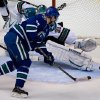 Vancouver Canucks\' Henrik Sedin, of Sweden, scores against San Jose Sharks\' goalie Antti Niemi, of Finland, during the second period of an NHL hockey game in Vancouver, British Columbia, Tuesday, March 5, 2013. (AP Photo/The Canadian Press, Darryl Dyck)
