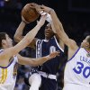 Oklahoma Thunder guard Russell Westbrook (0) shoots between Golden State Warriors\' Klay Thompson, left, and Stephen Curry (30) during the first half of an NBA basketball game Thursday, April 11, 2013, in Oakland, Calif. (AP Photo/Ben Margot)