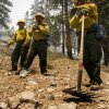 A Type 2 firefighters from Sequoia National Forest take a break from the Carpenter 1 Fire at the Rainbow subdivision on Mt. Charleston near Las Vegas on Tuesday, July 9, 2013. The lightning-caused fire, which started on July 1, has burned nearly 20,000 acres. Over 800 firefightersl are working the blaze in the Spring Mountains National Recreation Area. (AP Photo/Las Vegas Review-Journal, Jeff Scheid)