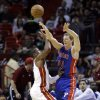 Detroit Pistons forward Kyle Singler (25) passes past Miami Heat guard Dwyane Wade during the first half of an NBA basketball game, Friday, Jan. 25, 2013, in Miami. (AP Photo/Wilfredo Lee)