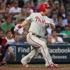 Philadelphia Phillies\' Laynce Nix follows through with a three-run double in the third inning of a baseball game against the Atlanta Braves in Atlanta, Wednesday, May 2, 2012. Braves catcher Brian McCann (16) watches at left. (AP Photo/John Bazemore)