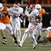 Oklahoma\'s Demarco Murray (7) runs past Oklahoma State\'s Johnny Thomas (12) and Oklahoma State\'s Jamie Blatnick (50) during the Bedlam college football game between the University of Oklahoma Sooners (OU) and the Oklahoma State University Cowboys (OSU) at Boone Pickens Stadium in Stillwater, Okla., Saturday, Nov. 27, 2010. Photo by Bryan Terry, The Oklahoman