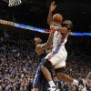 Oklahoma City\'s James Harden (13) is fouled by Denver\'s Wilson Chandler (21) during the NBA basketball game between the Denver Nuggets and the Oklahoma City Thunder in the first round of the NBA playoffs at the Oklahoma City Arena, Wednesday, April 27, 2011. Photo by Bryan Terry, The Oklahoman